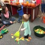 Kids raking leaves